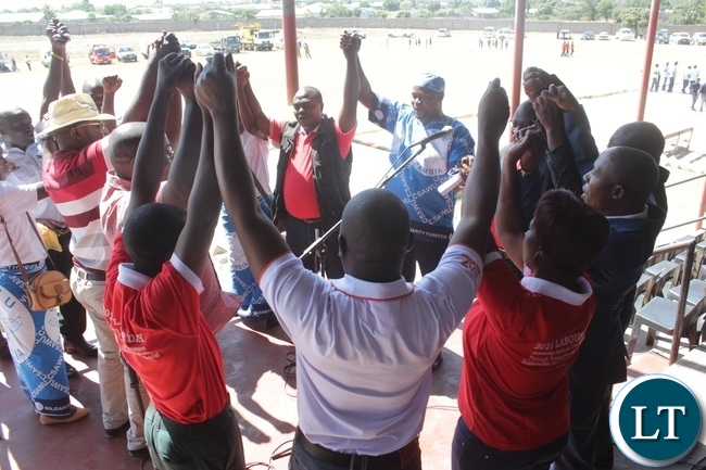 Western Province Trade Unionists sing a song of solidarity during the 2016 Labour Day Celebrations at Mongu stadium