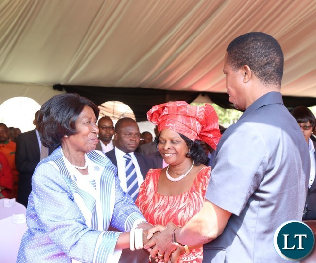 President Edgar Lungu(r) being welcomed by Vice President Inonge Wina(l) while the First Lady Esther Lungu looks on during the celebration of Africa Freedom day at State House