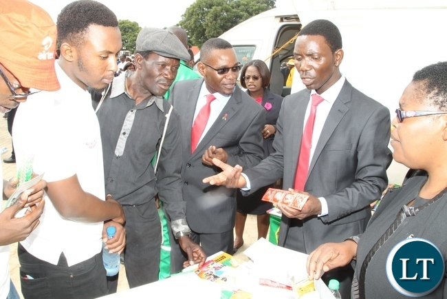 Zambia National HIV/AIDS/STI/TB Council staff giving out Condoms during Labour Day celebrations
