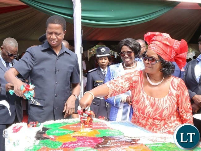 President Edgar Lungu(l) and his First Lady Esther Lungu(r) cutting the Africa Freedom day cake while the Vice President Inonge Wina looks on during the celebration of Africa Freedom