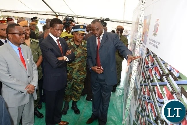 Project architect Mulungushi Wesley shows President Edgar Lungu the Map of the Project during the official the ground breaking ceremony of ZAF twin Palm Public Private Partnership Project on Support Social Amenities and Commercial Facilities whilst Lt Muwindwa Liusha helps at the launch