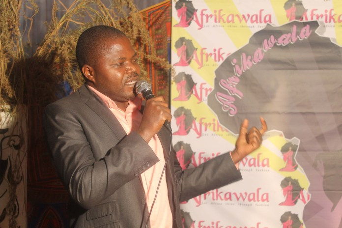 Acting District Administrative Officer Mr Morris Kabanda speaks during the fashion show