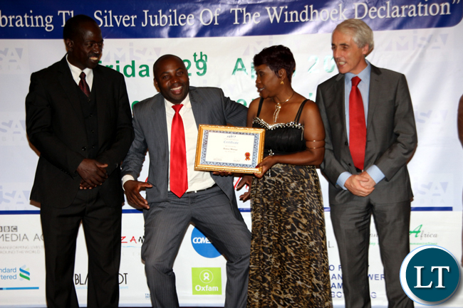 Blogger and media trainer Richard Mulonga poses for a photograph after receiving special recognition for best community blog during the 2016 MISA Zambia annual awards in Lusaka on April 29, 2016.