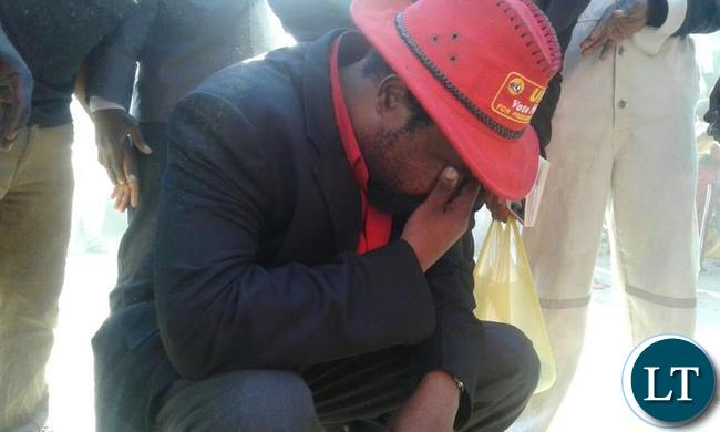 Dr Canicius Banda wipes his eyes after tear gas was thrown at the UPND youth rally