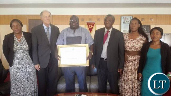 Dr Kambwili displays his certificate