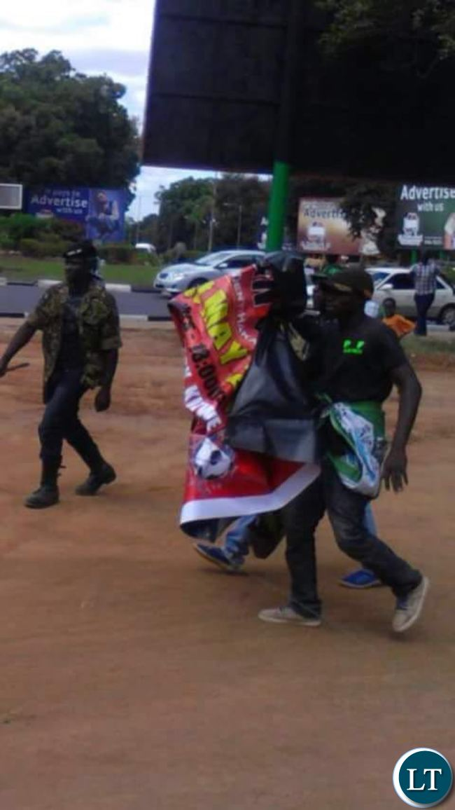 UPND cadres carrying UPND banners