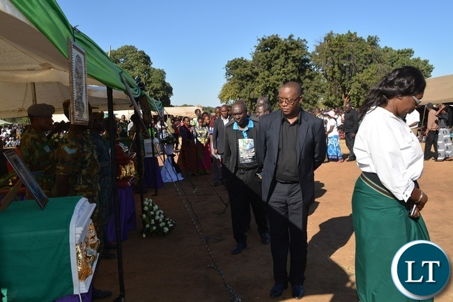 Ministry of General Education Spokesperson Hillary Chipango (in black T-shirt) pays his last respect during the burial of Hillcrest National Technical Secondary School accident victims at Villa Grounds in Livingstone.Picture by KELVIN MUDENDA