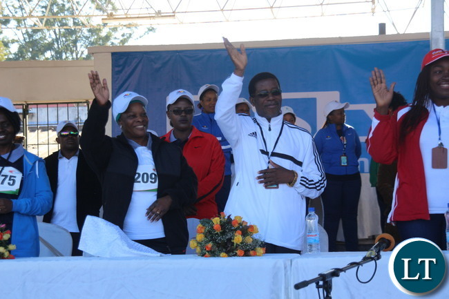 Zambia 1st lady Esther Lungu with ZAAA President greeting the athletes during the march past prior to the flag off.