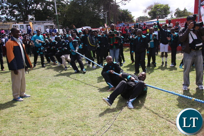 Tug of war involving teams of : ZNS (male and female) and National Airport Corporation.