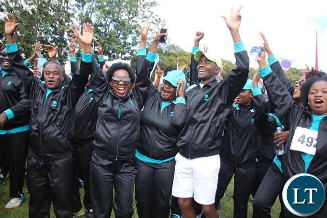 FNB team celebrating the Thug of War winning over Zambia Sugar Tea