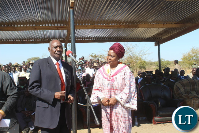 veteran politician Vernon Mwaanga(right) who together with former First Lady Dr Maureen Mwanawasa(left)  represented the Patron of the ceremony,  United Party for National Development(UPND) president Hakainde Hichilema,  speak after they handed over  K30,000 cash donated by the patron to the organisng committee.