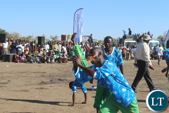 ELEVEN:EATING FIRE! Acrobats entertain the crowd at the Inaugural Samu Lya Moomba held in Choongo chiefdom