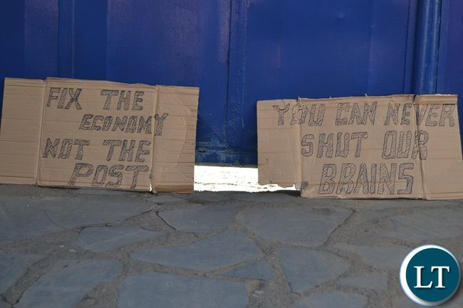 Some placards outside the closed Post Newspapers
