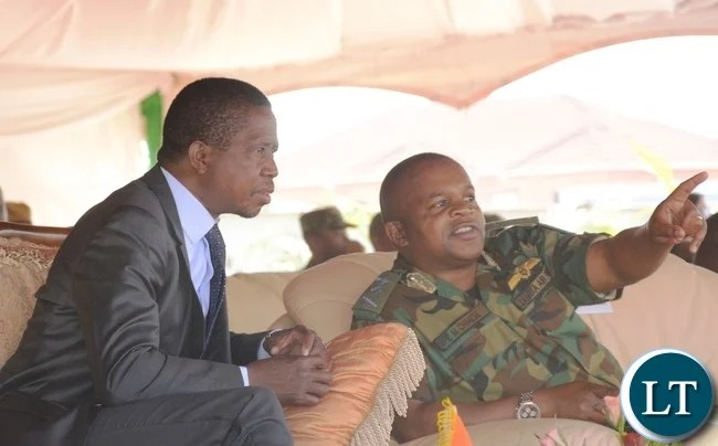 Zambia Air force Commander Lt Gen Eric Chimese(r) points where the Hospital is while President Lungu(l) looks on at Zambia Air Force Headquarters during the official opening of Zambia Air Force Hospital