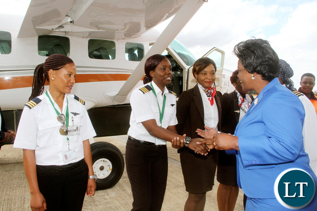 First Lady Esther Lungu greets female pilots during the official Launch of Women in Aviation Zambia Chapter at Kenneth Kaunda International Airport on Thursday, July 14,2016 -Picture by THOMAS NSAMA