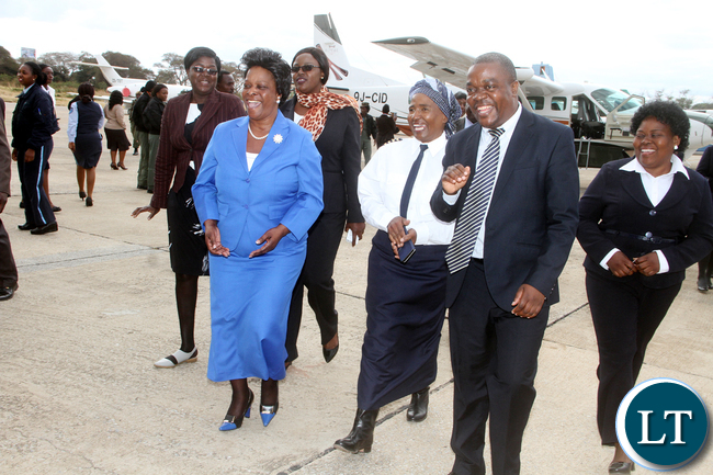 First Lady Esther Lungu share a light moment with Women in Aviation Chairperson Captain Yichidi Ndhlovu and Ministry of Transport and Communications Permanent Secretary Misheck Lungu duuring the officialn Launch of Women in Aviation Zambia Chapter at Kenneth Kaunda International Airport on Thursday, July 14,2016 -Picture by THOMAS NSAMA
