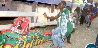 PF cadres displays a mock coffin of Opposition UPND party leader Hakainde Hichilema and his running mate Geoffrey Bwalya Mwamba in Kasama on Tuesday, July 19,2016 -Picture by THOMAS NSAMA