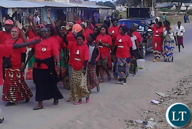 United Party for National Development (UPND) Serenje Central aspiring candidate Clarissa Chikamba (Second from right) leads her supporters through the Serenje Central Business District (CBD) during a procession to mobilize support