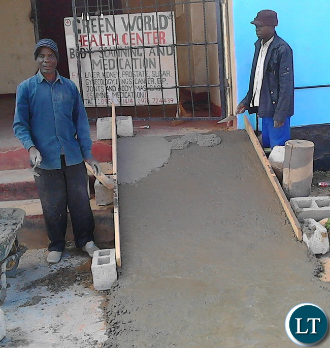 A contractor,Blackson Maida (Left) erecting a ramp at the Serenje district council hall in readiness for the August 11 general elections. The Electoral Commission of Zambia (ECZ) is erecting ramps at all the polling station in the district to make the facilities accessible to the physically challenges voters.