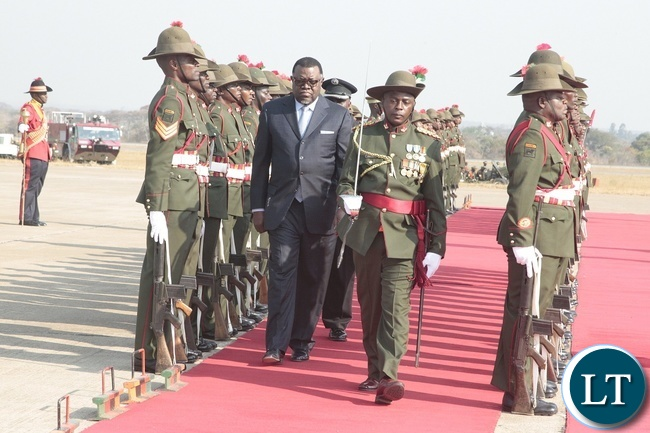 PRESIDENT of Namibia, Hage Geingob inspect the guard of honour on arrival at Kenneth Kaunda International Airport.