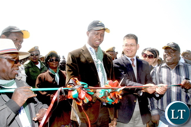 President Lungu cutting the ribbon with Chinese Ambassador to Zambia Yang Youming as First Lady Esther Lungu and Works and Supply minister Yamfwa Mukanga (r) looks on during the commissioning of Mansa-Luwingu Road in Luwingu   on Monday, July 18,2016 –Picture by THOMAS NSAMA