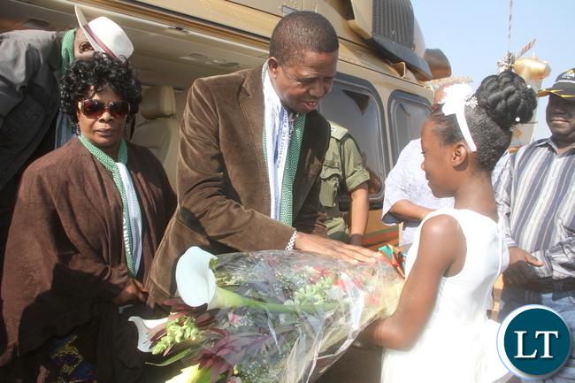 President Lungu receives a flower from Jenince Munyimba as First Lady Esther Lungu looks on on arrival in Luwingu for the Commissioning of Mansa Luwingu Road on Monday, July 18,2016 –Picture by THOMAS NSAMA