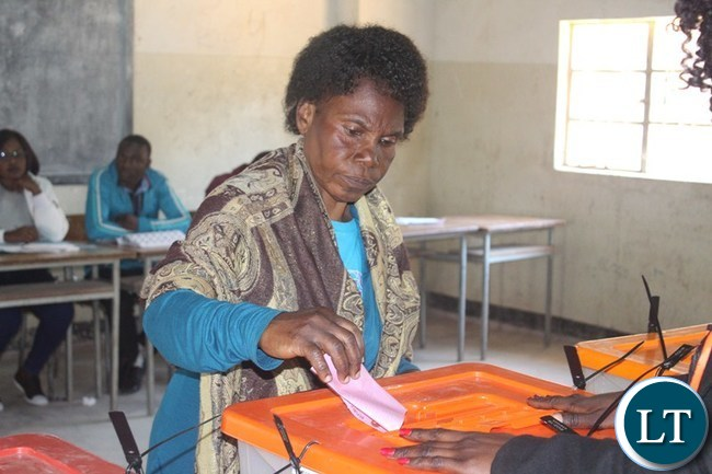 MANY Zambians turned up to vote in the 2016 General Elections. On the picture is a Zambian patriot Rodina Maluma casting her ballot paper at Chuundu Adult School polling station in Choma yesterday.