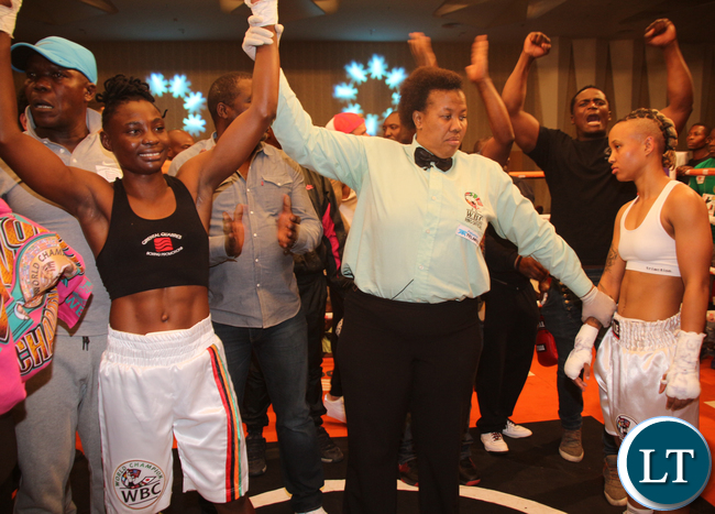 WBC Referee/ Judge Silvia Mokaila. declaring Catherine Phiri a winner.