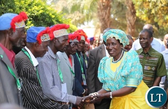 VICE President Inonge Wina greets the subordinate chiefs on arrival at the Mwata's palace in Mwansabombwe.