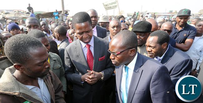President Edgar Lungu  with Amos Chanda and Kaizah Zulu tour Bauleni Market Burned