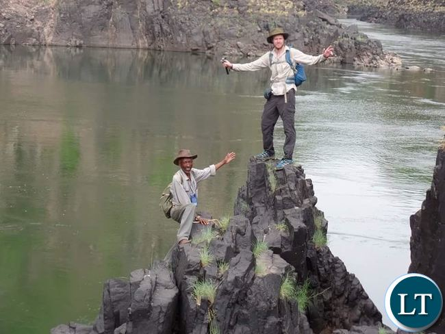 Livingstone based retired medical doctor Teddy Mulenga (left) and British National Chaz Powell (right) pose for a picture on Zambezi River in readiness for their long journey from the source of Zambezi River in Northern Western Province of Zambia to Mozambique
