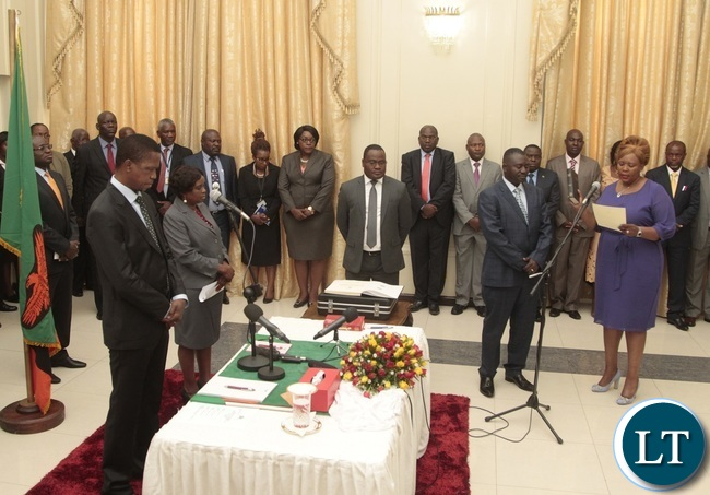 Newly appointed Minister of Agriculture Dora Siliya taking Oath before President Edgar Lungu during swearing in ceremony at State House