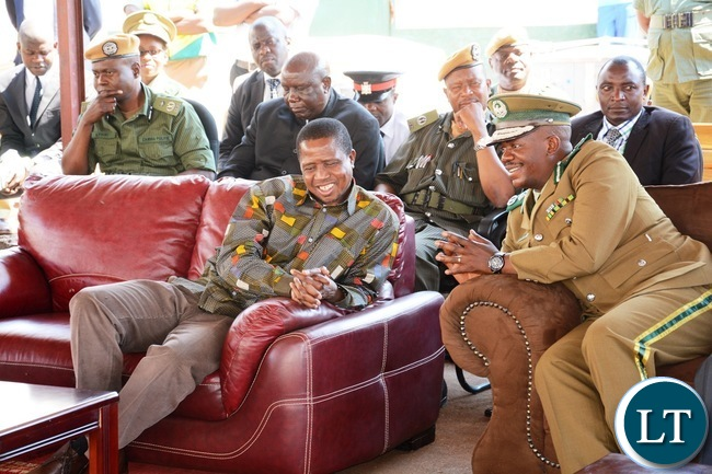 President Edgar Lungu chats with Zambia Correctional Services Commissioner General Percy Chato during the donation goods by President Lungu to the inmates