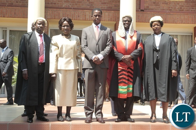 President Edgar Lungu (c) Vice President Inonge Wina (2nl) Speaker of the National Assembly Patrick Matibini(2nr) First Speaker of the National Assembly Catherine Namugala (r) and Newly appointed second Speaker of the National Assembly Mwemba Malama (l) taking official photo after swearing in Ceremony at State House