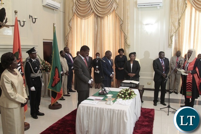 Newly appointed Speaker of the National Assembly Patrick Matibini taking orth before President Edgar Lungu and his Vice President Inonge Wina during swearing in Ceremony