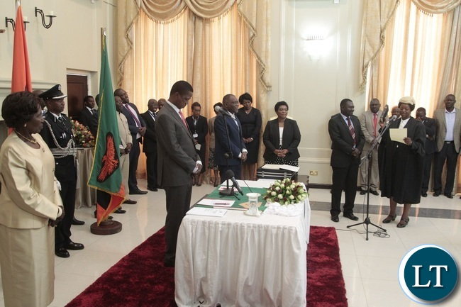 Newly appointed first Speaker of the National Assembly Catherine Namugala taking orth before President Edgar Lungu and his Vice President Inonge Wina during swearing in Ceremony