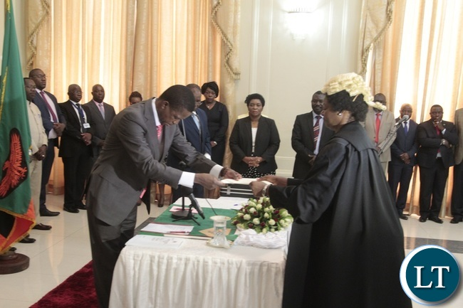 President Edgar Lungu receives latter of orth from Newly appointed first Speaker of the National Assembly Catherine Namugala during swearing in Ceremony