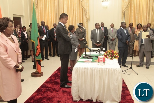 Newly appointed Minister of General Educaton Dennis Wachinga taking Oath before President Edgar Lungu and Vice President Inonge during swearing in ceremony at State House
