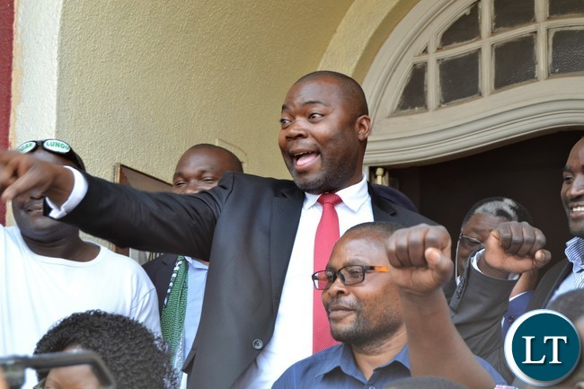 Copperbelt Minister Bowman Lusambo gestures to his supporters after he was introduced to a group of cheering supporters who gathered to welcome him to Ndola
