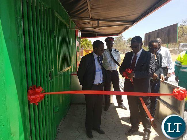 L-R Mr Kaziwe Kaulule, Rev Howard Sikwela and Ms Thecra Milambo before cutting the ribbon