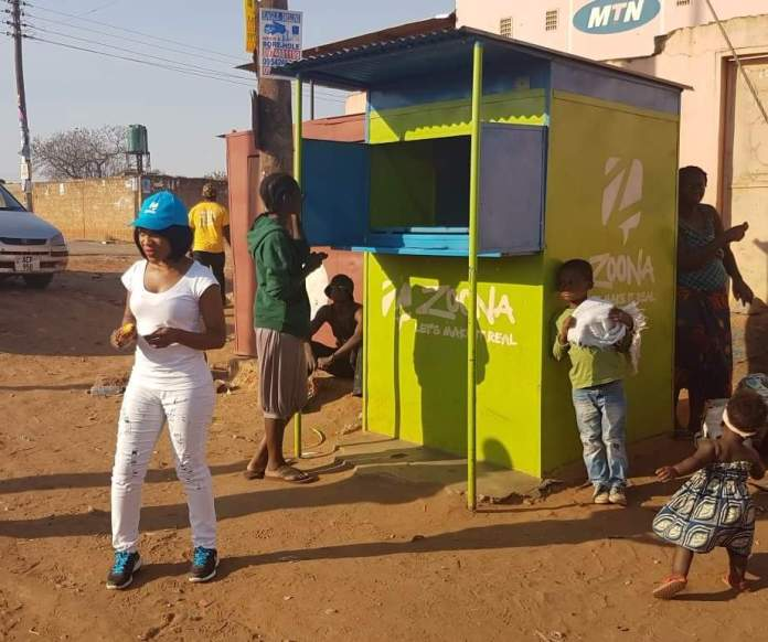 Mwansa in the community searching for nominees and conducting surveys for Zoona