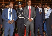 President Lungu flanked by his political adviser Kaizer Zulu departing for America