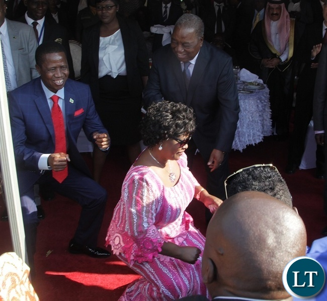 PRESIDENT Edgar Lungu with the First Lady, Esther Lungu doing what they know best during the Luncheon at State House.