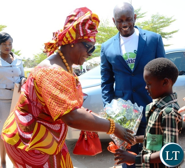 First Lady Esther Lungu(l) being welcomed by a Grade One pupil of North mead Primary School Natasha Namukwanya(r) at Giacomo Global Hand Washing Day at North mead Primary School