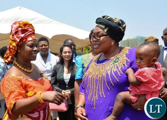 First Lady Esther Lungu(l) chats with former first Lady Vera Tembo Chiluba(r) and her grandchild Safira during Giacomo Global Hand Washing Day at North mead Primary School
