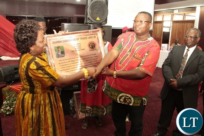 ZCTU President Chishimba Nkole presents the award to Minister of Labour Joyce Nonde on behalf of President Edgar Lungu during Zambia Congress Trade Union Golden jubilee award Celebration at Mulungushi Conference Center