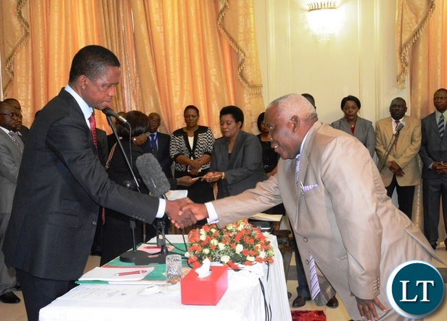 President Edgar Lungu(l) congratulates the newly appointed Minister of  Presidential Affairs(State House)  Freedom Sikazwe(r) during the Swearing in Ceremony at State House