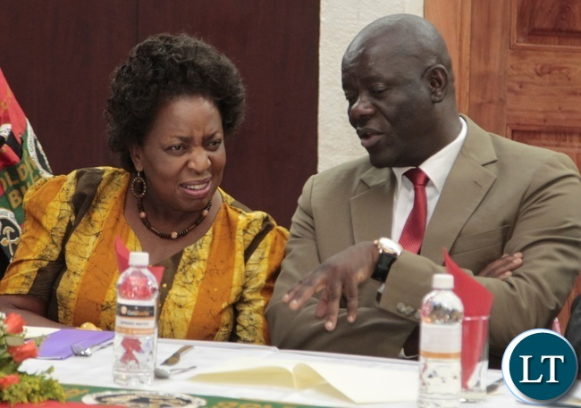 PF Secretary General Davies Mwila chats with Minister of Labour Joyce during Zambia Congress Trade Union Golden jubilee Celebration at Mulungushi Conference Center