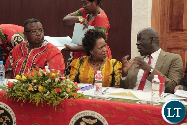 PF Secretary General Davies Mwila chats with Minister of Labour Joyce and ZCTU President Chishimba Nkola during Zambia Congress Trade Union Golden jubilee Celebration at Mulungushi Conference Center