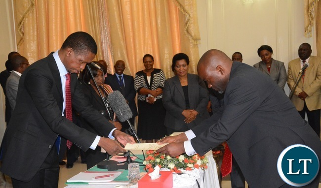 President Edgar Lungu(l) swears in Loyd Kaziya as Minister of Water and Sanitation during the Swearing in Ceremony at State House